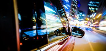 driving through city lights PHSNYUZ 370x180 - The Joy of Daily Driving: A Sensory Experience Like None Other