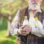 farmer with milk bottles PS2A8Y9