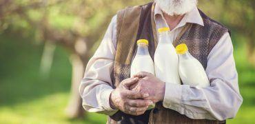 farmer with milk bottles PS2A8Y9 370x180 - Memory Lane: The Milkman Mentor