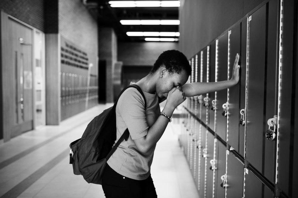 young sad student on the hallway PVGM3B5