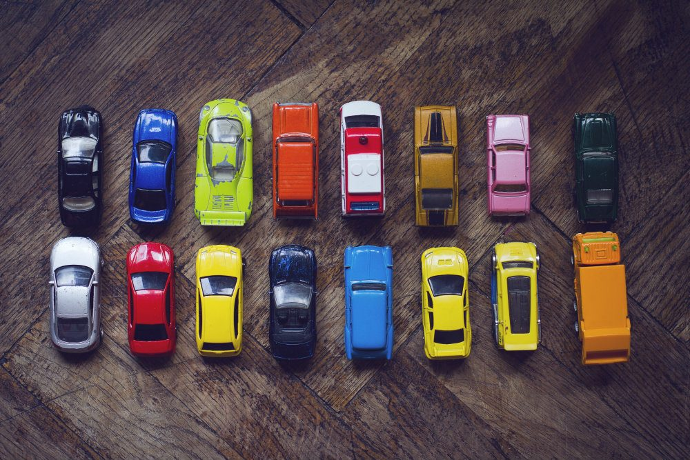 assorted colorful car collection on floor PJP6SNN