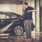 man worker washing luxury car on a car wash PE2NHXS
