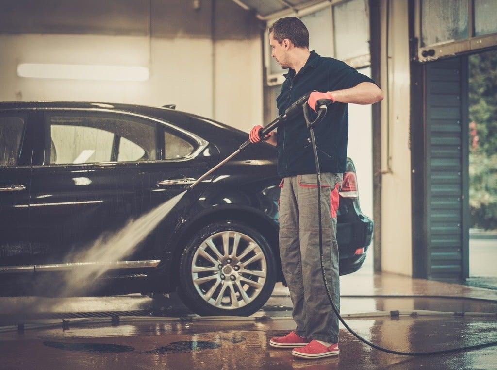 man worker washing luxury car on a car wash PE2NHXS