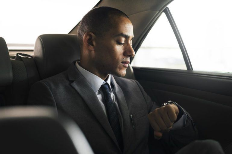 businessman sit inside car waiting PJLJEF9