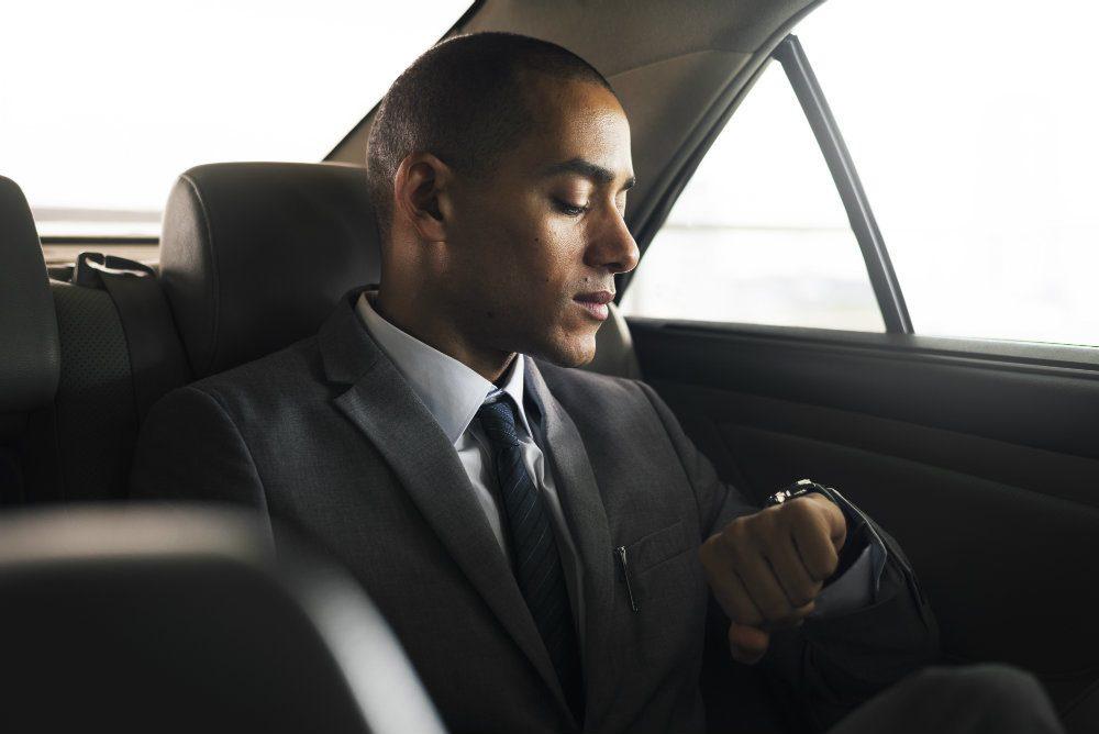 businessman sit inside car waiting PJLJEF9