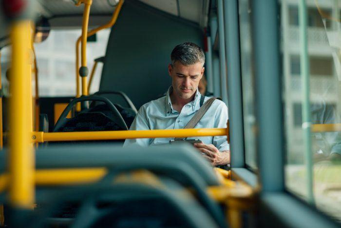 businessman traveling by bus PFGB44X