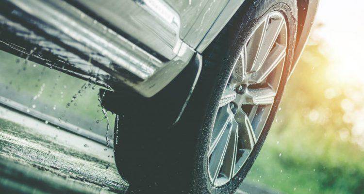 Car In The Rain  750x400 - When To Change Your Tires? The Answer Is Sooner Than We Think!