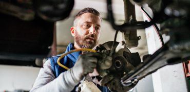 mechanic brakes  370x180 - Here Are The Most Common Seasonal Car Repairs