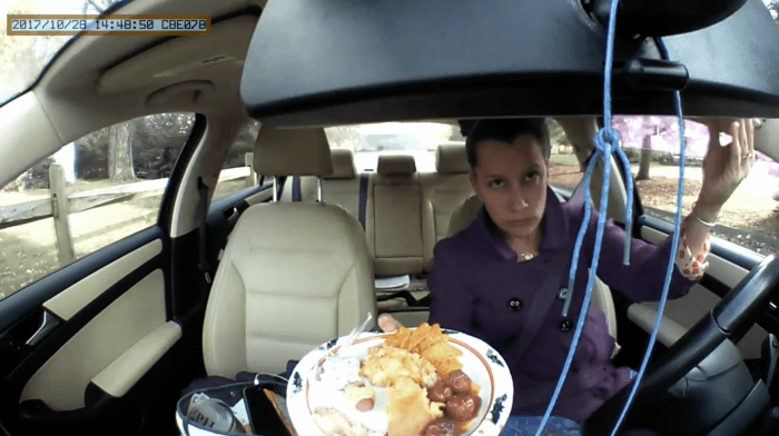 Katie eating in her car captured with in car camera
