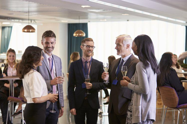 delegates networking at conference drinks PLCKMY7