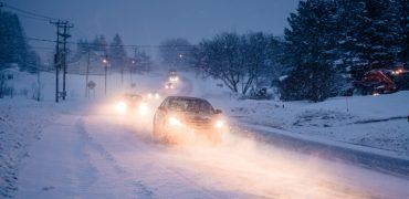blizzard on the road during a cold winter evening P4QLUP3 370x180 - Winter Driving 101: The Complete Guide To Staying Safe & Ready