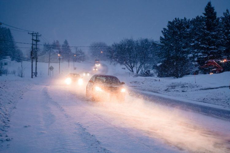 blizzard on the road during a cold winter evening P4QLUP3