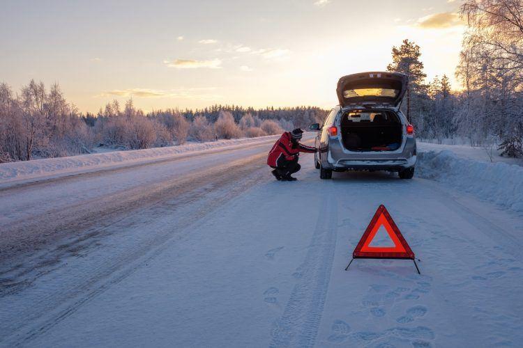 broken on a snowy winter road P94P7KH