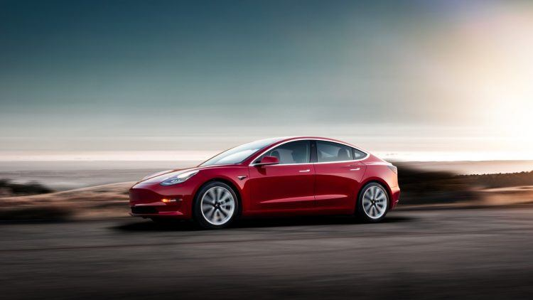 Model 3 Red Driving Sunset
