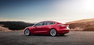"Model 3 Red Rear Sunset 370x180 - Tesla Finally Enters ""Affordable EV"" Arena With Base Model 3"