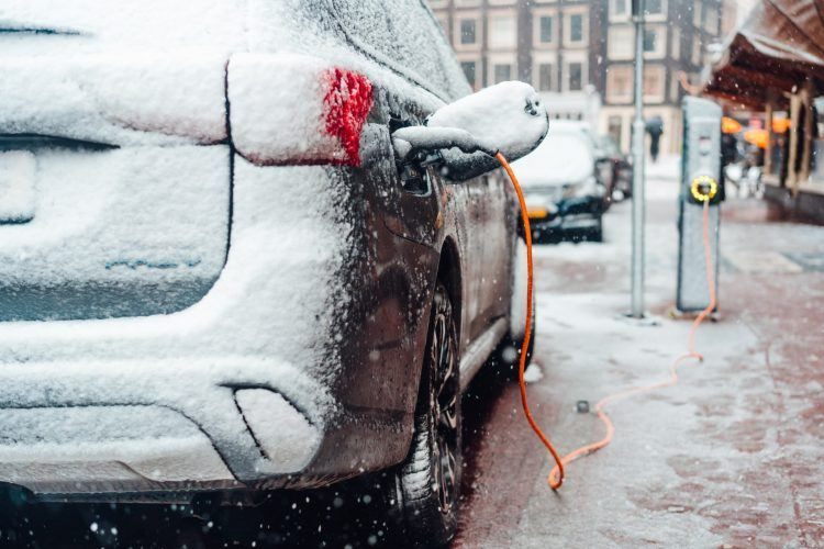 electric car plug charging in the winter 2NYVKW4 1