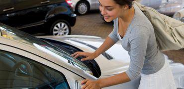 Woman looking at a car