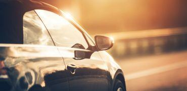 Car driving down the road 370x180 - Top Companies for Extended Warranties for Cars Over 100k Miles