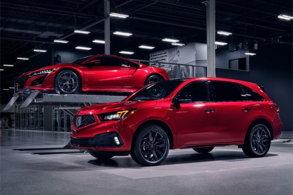 2020 Acura MDX PMC Edition in Valencia Red Pearl with the NSX in the background.