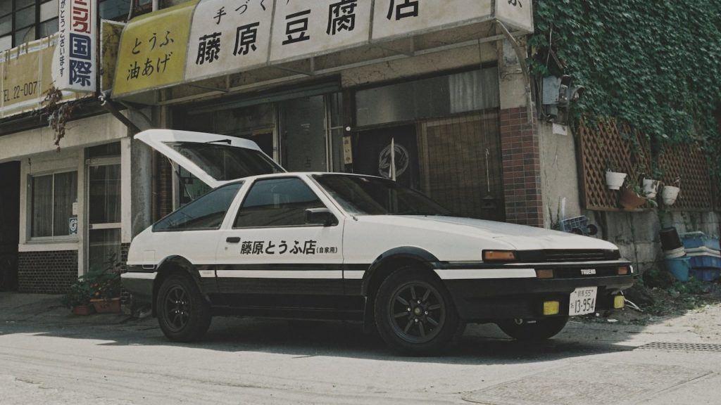 Takumi Fujiwara's AE86 in front of his father's tofu shop in Initial D.