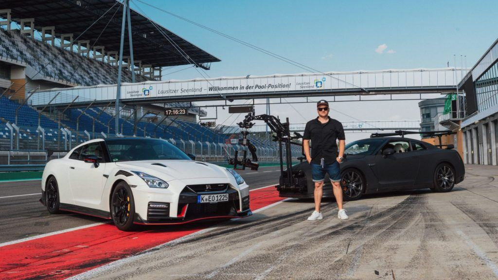 Mauro Calo with the Nissan GT-R Camera Car behind him.