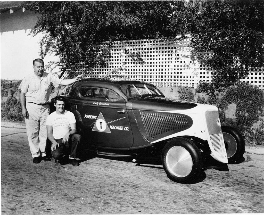p129  Craig with his Ford coupe and sponsor Ed Perkins circa 1959 Photo Credit William A. Moore