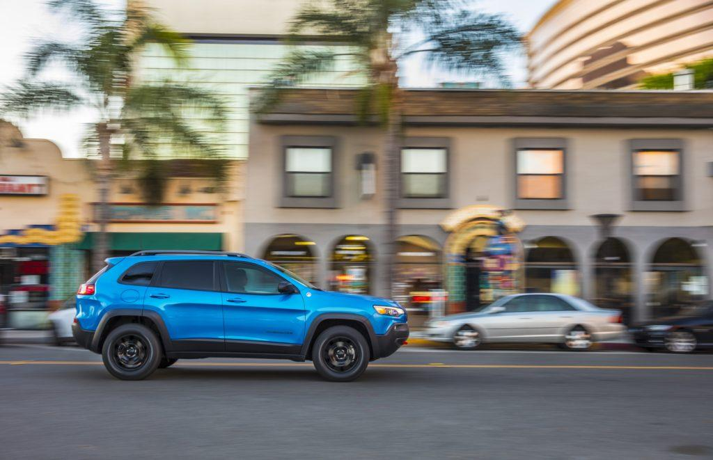 2020 Jeep Cherokee Trailhawk cruising through the city.