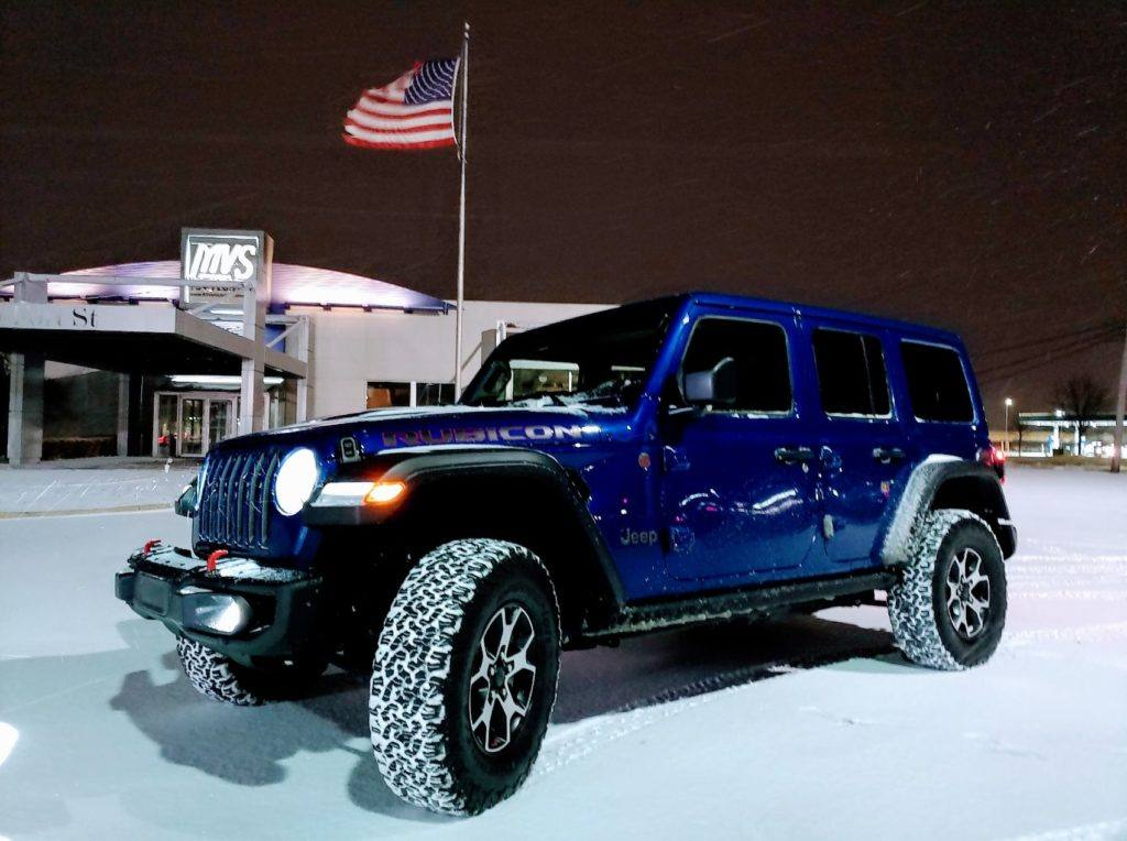 Our 2020 Jeep Wrangler Unlimited Rubicon press vehicle. The first night we had it, a snowstorm blanketed the Detroit metro. We didn't get to enjoy the shiny blue paint for long, but we were able to test out the 4x4 system.