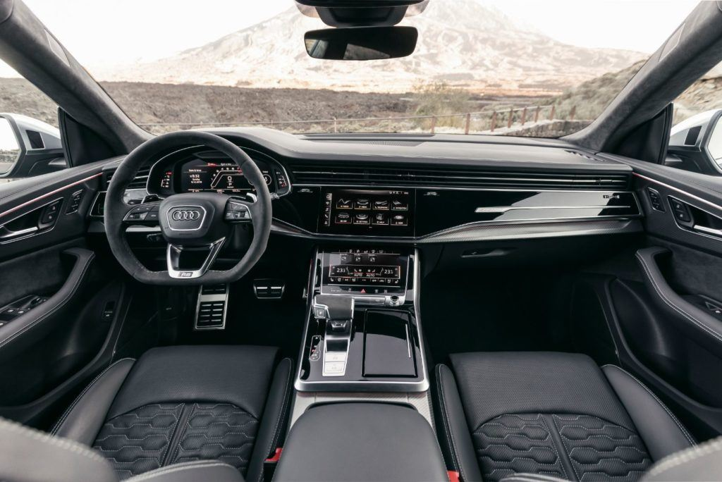 "2020 Audi RS Q8 interior layout. The ventilated Valcona leather seats feature ""RS"" honeycomb stitching. A heated leather steering wheel, with large aluminum shift paddles, is also standard."
