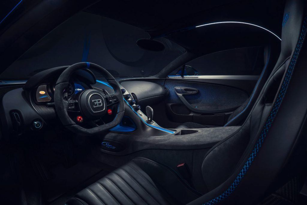 """Bugatti Chiron Pur Sport interior layout. Special patterns have been laser-etched into the Alcantara door trim panels, which feature contrasting highlights that give off a """"metal look."""""""