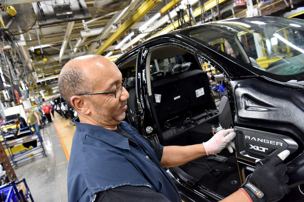 Duane Moore, Ford Motor Company employee, applies a badge to a 2019 Ranger at Michigan Assembly. Ford has temporary closed the facility after an employee tested positive for Coronavirus.