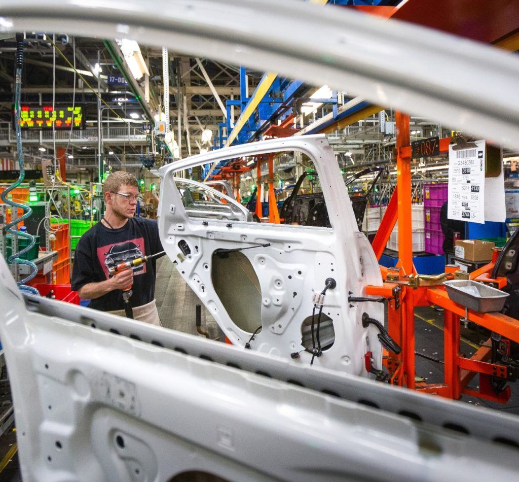A General Motors employee works on the assembly line Friday, April 26th, 2019 at Fairfax Assembly & Stamping Plant in Kansas City, Kansas. The Fairfax facility produces the Cadillac XT4 and Chevrolet Malibu. GM is suspending manufacturing operations in North America due to market conditions and to deep clean facilities in response to the Coronavirus. Photo: General Motors.