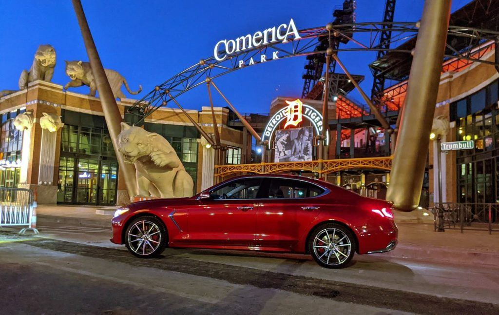 Our 2020 Genesis G70 Sport M/T (manual transmission) press vehicle outside of Comerica Park in downtown Detroit. The exterior paint is called Havana Red. Note the red Brembo brake calipers as well.