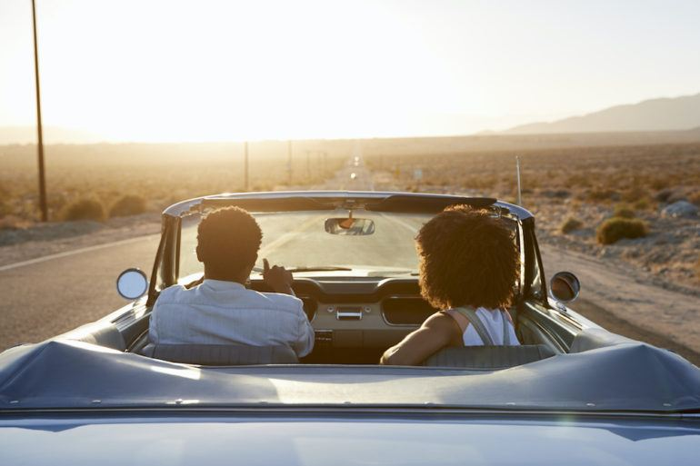 Couple driving with California car insurance