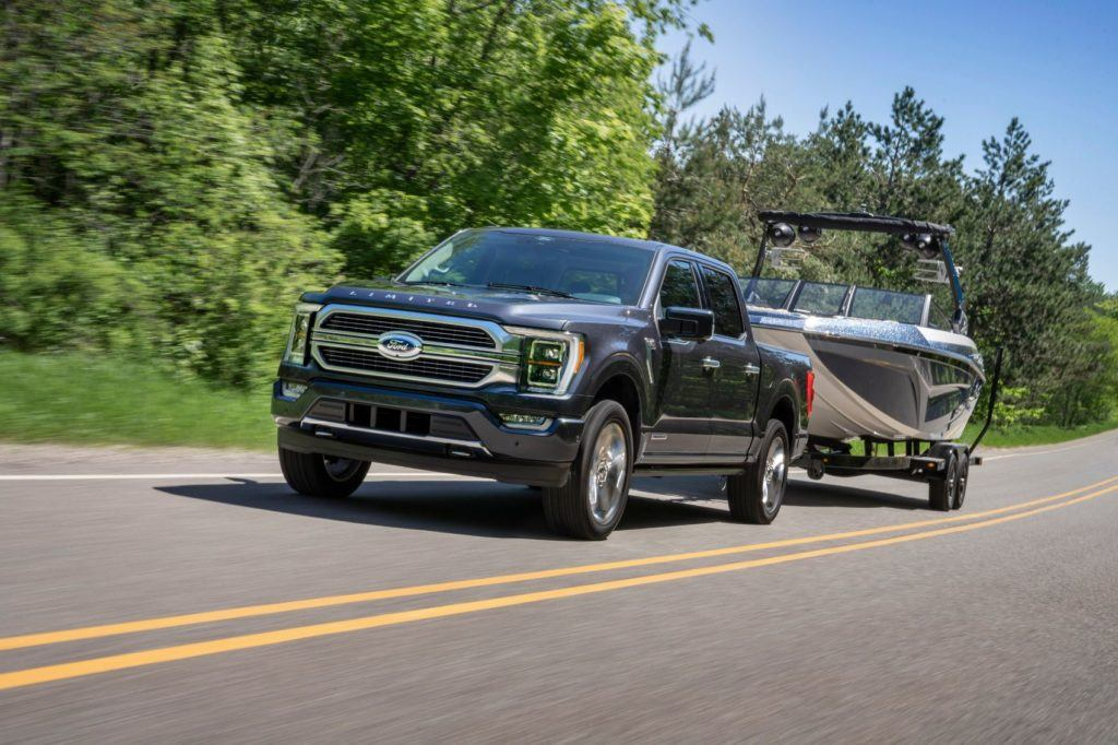 2021 Ford F-150 towing a boat. All 2021 Ford F-150 engines are mated to a 10-speed automatic transmission.