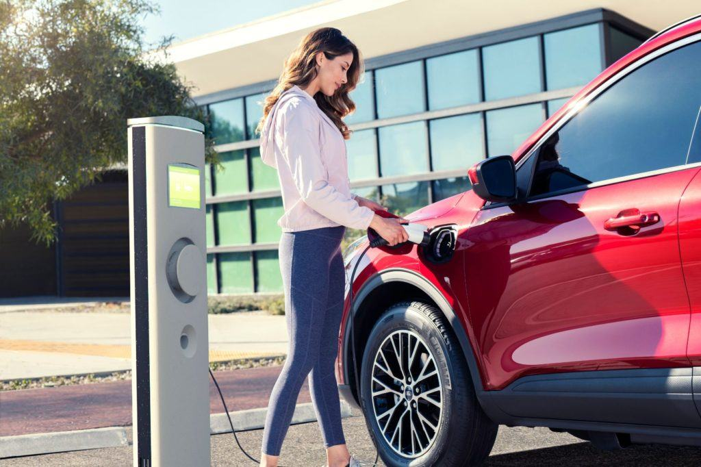 Ford Escape Plug-In Hybrid at a charging station.