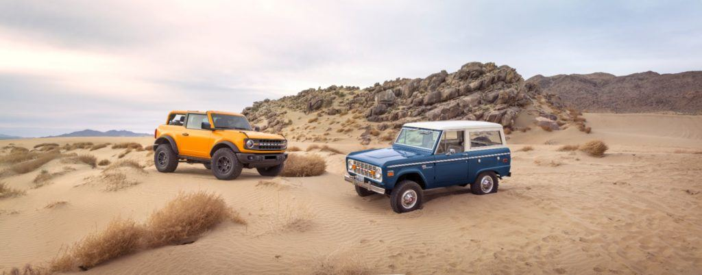 2021 Ford Bronco next to a classic Bronco.