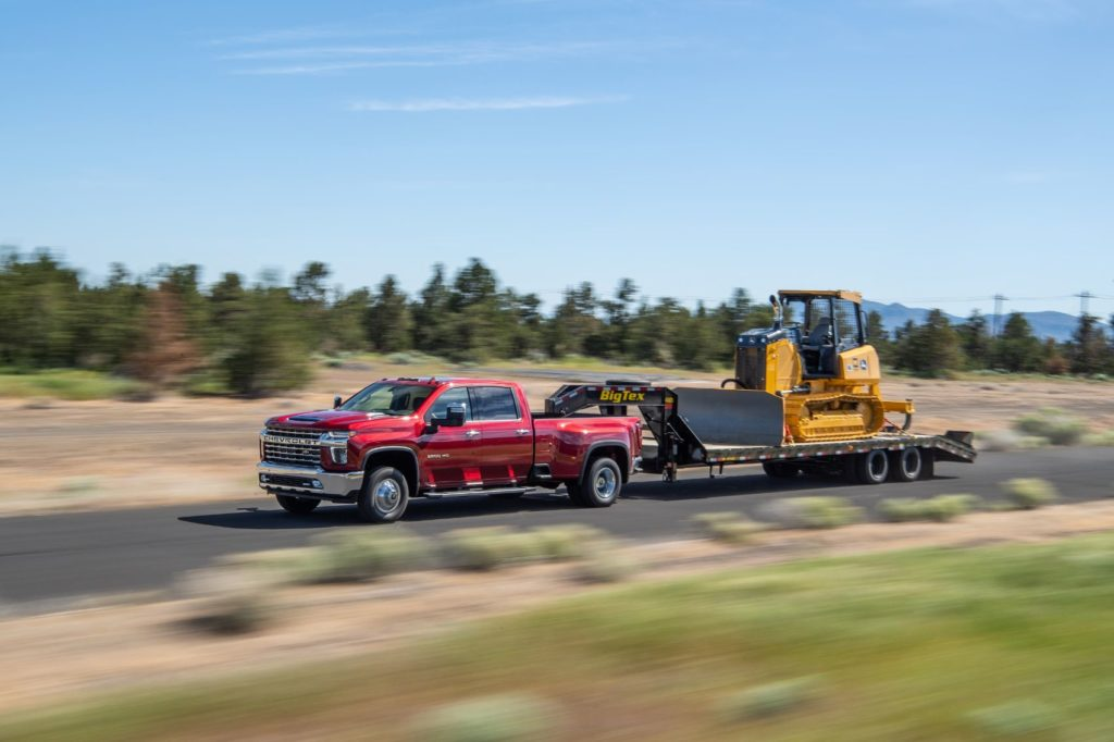 2021 Chevy Silverado HD towing on the open road.