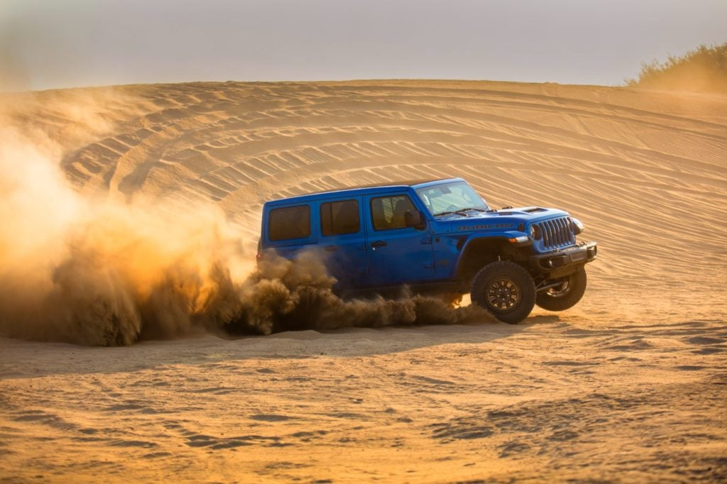 2021 Jeep Wrangler Rubicon 392 driving in the sand.