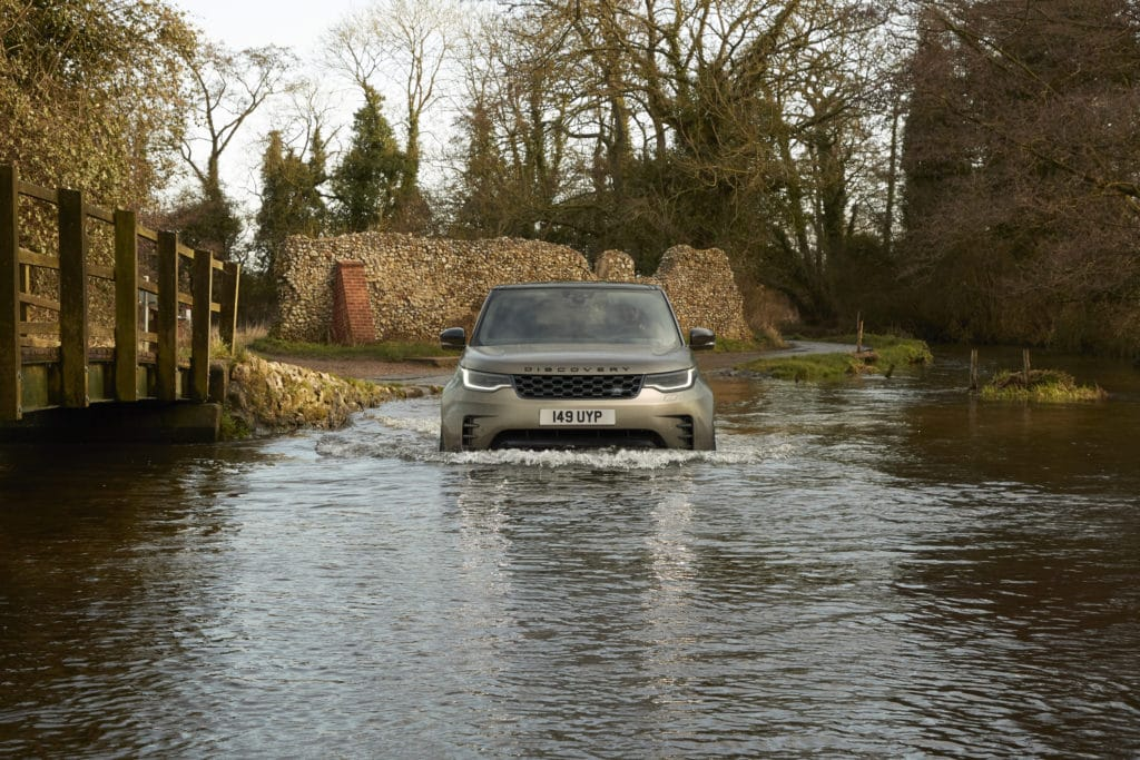 2021 Land Rover Discovery fording water.
