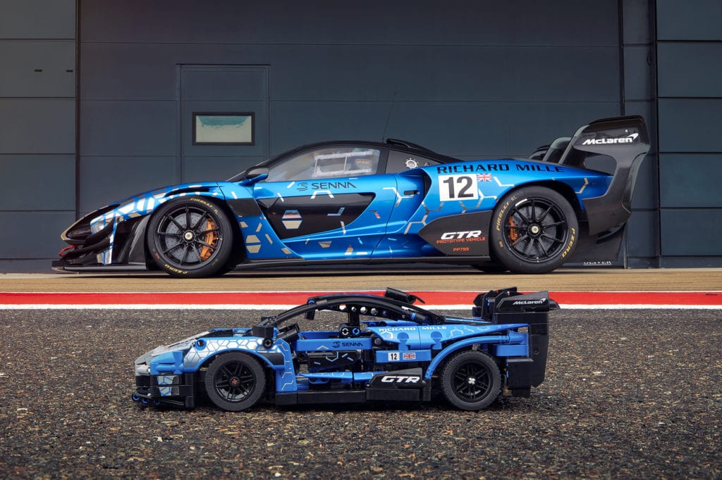 The LEGO Technic McLaren Senna GTR includes a V8 engine with moving pistons, dihedral doors that swing open, and a one-of-a-kind blue livery.