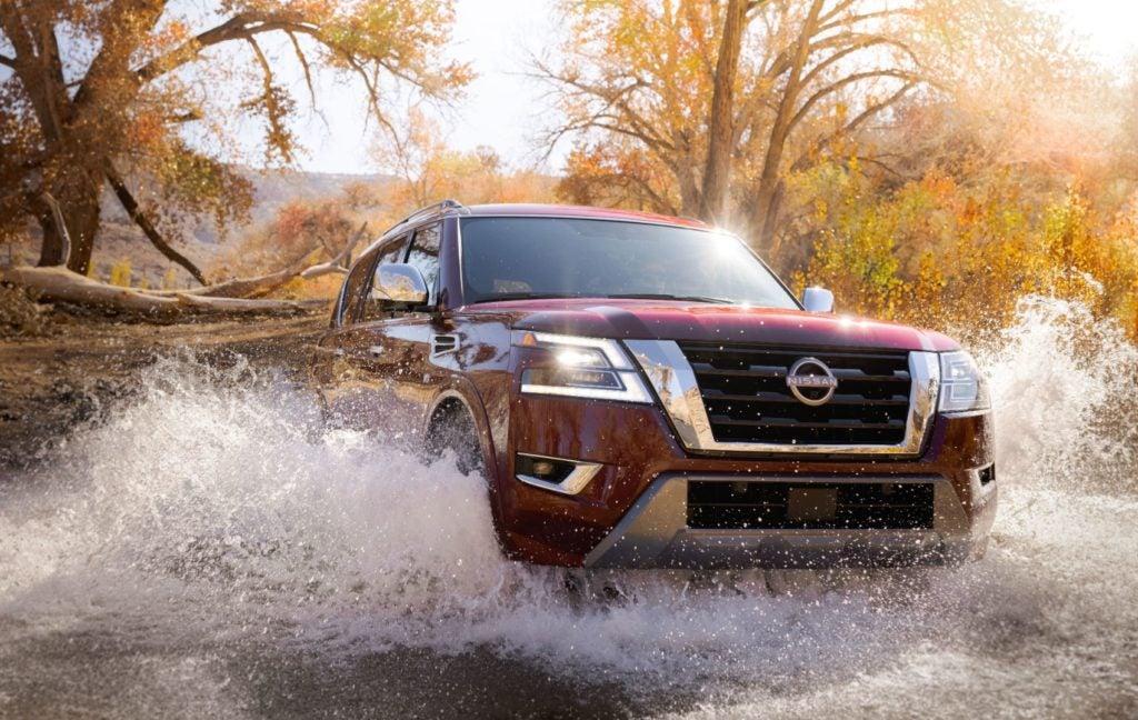 2021 Nissan Armada driving off-road through a small river.