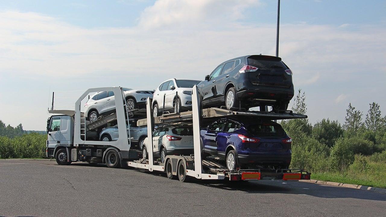 transportation of new cars on a road train