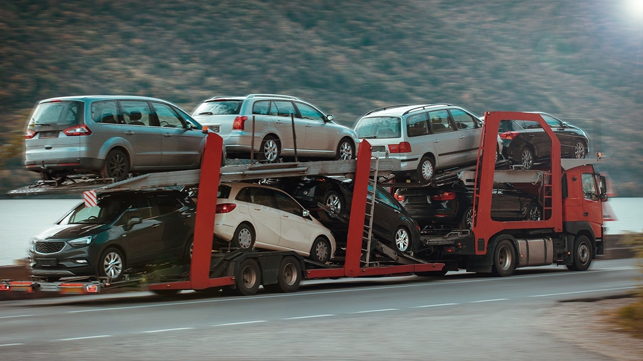 Car carrier in motion. Auto industry, cars export- concept.