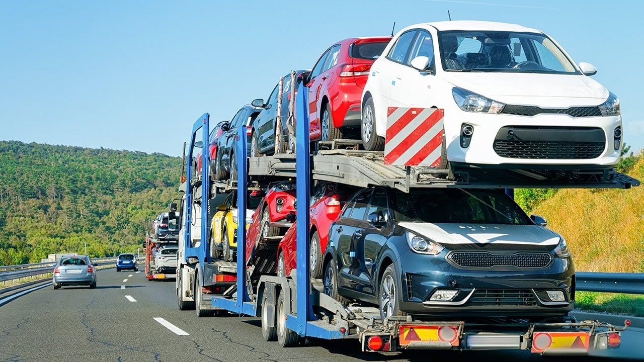 Cars carrier truck in the asphalt highway, Poland. Truck transporter